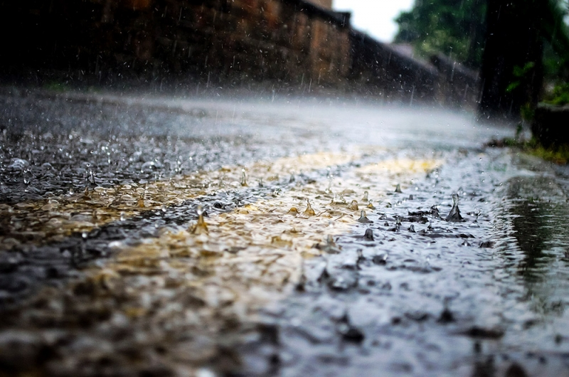 Rain soaked road in winter